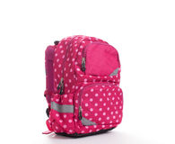 Pink school backpack with white dots isolated on white stock images