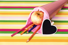 Pink school bag with crayons and heart Royalty Free Stock Photo