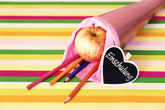 Pink school bag with german text for enrollment Stock Images