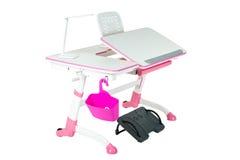 Pink school desk, pink basket, desk lamp and black support under legs Royalty Free Stock Photo