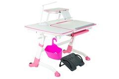 Pink school desk, pink basket, desk lamp and black support under legs Royalty Free Stock Image