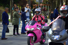 Pink scooter female biker Royalty Free Stock Image