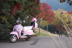 Pink scooter and helmet Royalty Free Stock Image