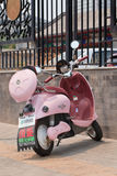 Pink scooter parked in front of a fence, Beijing, China Stock Photos