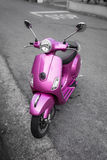 Pink scooter on the street. Pink italian scooter on the street Royalty Free Stock Photo