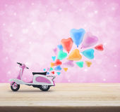Pink scooter toy with colorful heart love balloon on wooden tabl Stock Photography