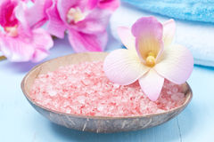 Pink sea salt, flowers and towels Royalty Free Stock Image