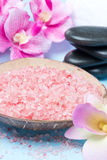 Pink sea salt, stones for spa and flowers Royalty Free Stock Photos