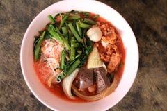 Pink seafood flat noodle. & x28;Tom Yum Yen-Ta-Fo& x29 Royalty Free Stock Image