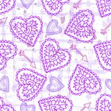 Pink seamless pattern with hearts on a backround. Stock Images