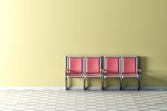 Pink seats on yellow wall Royalty Free Stock Photo