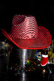 Pink Sequin Cowboy Hat, Ice Bucket Lid. Pink cowboy party hat adorned with sequins, covering an ice bucket, at a party Stock Image