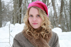 Pink Sequined Beret and Fur Jacket Winter Woman. Portrait of a slightly smiling, wholesome, beautiful young woman wearing a fur jacket and pink beret in a snowy Stock Photography