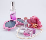Pink set of cosmetics in pink Stock Images