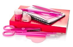 Pink set of school accessories with tutorial Royalty Free Stock Photos
