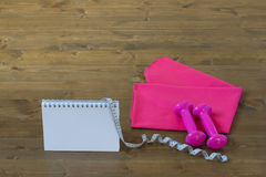 Pink set for the sport with a notebook Royalty Free Stock Photos