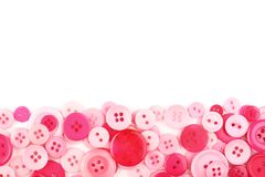 Pink sewing buttons stock photo
