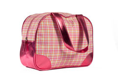Pink shiny bag. Checkered multicolored bag with pink leather handles and corners Stock Photo