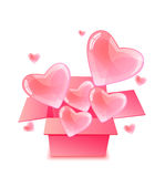 Pink shiny hearts flying out the box Royalty Free Stock Photography