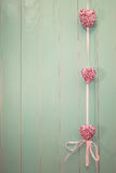 Pink shiny hearts on vintage green wood background Royalty Free Stock Photography