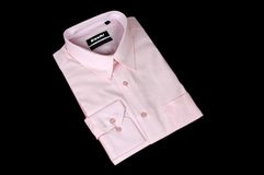 Pink shirt. A pink shirt isolated on black background Stock Image