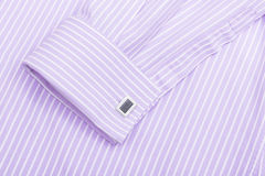 Pink shirt collar and cuff links. Sleeve of a striped pink shirt with a cuff link isolated on white background Stock Images