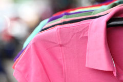 Pink shirt on a hanger. Stock Photo