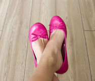 Pink shoes. Bare female legs in pink balerina shoes Royalty Free Stock Image