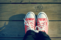 Pink shoes. Pink tennis shoes on a boardwalk Royalty Free Stock Images