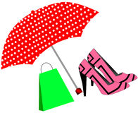 Pink shoes and bag under the umbrella Royalty Free Stock Image