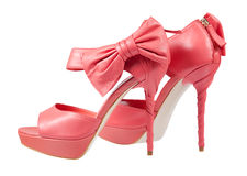 Pink shoes with a bow on a high heel Stock Images