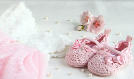 Pink shoes, dress and bandage on his head for a little princess. Stock Photos