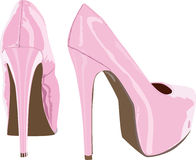 Pink shoes. Pink high-heeled shoes on a white background Stock Photos