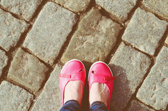 Pink shoes and jeans legs Royalty Free Stock Images
