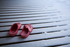 Pink shoes at a snowy floor Royalty Free Stock Photo