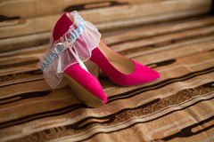 Pink shoes and wedding garter Royalty Free Stock Images