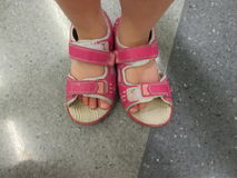 Pink shoes in wrong feet Royalty Free Stock Photos