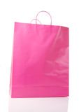 Pink Shopping Bag. With reflection on white background Royalty Free Stock Images