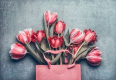 Pink shopping bag with beautiful tulips bunch Stock Image