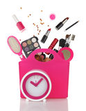 Pink shopping bag and clock. With various cosmetics isolated Royalty Free Stock Images