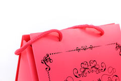 Pink shopping bag with swirl design closeup Stock Images
