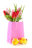 Pink shopping bag with tulips and eggs Royalty Free Stock Images