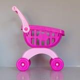 Pink shopping cart Royalty Free Stock Photo