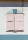 Pink Shutters on Stucco Wall Royalty Free Stock Images
