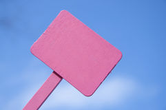 Pink Sign on Bright Blue Cloudy Sky Stock Photo