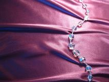Texture of pink silk with crystal beads. On pink silk with drapery crystal beads Royalty Free Stock Photography