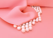 Pink silk and pearls. Royalty Free Stock Image