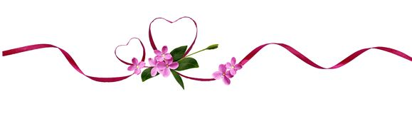 Pink silk ribbon hearts and small flowers for Valentine`s day Stock Photos