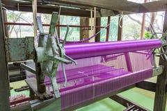 Pink silk weaving. Stock Photo
