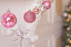 Pink and silver christmas balls and christmas lights on background.New Year greeting cards. Christmas holiday decoration royalty free stock photo